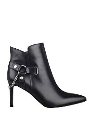 Online Exclusive Sleek, smooth and seriously sexy, these pointed-toe booties are your key to effortless seduction. The rebellious chain and vamp-inspired silhouette bring modern edge to your day-to-night looks.
