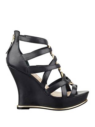 Gold-tone hardware and overlapping straps make these wedges a wardrobe must for warmer temperatures. Pair them with your day or night looks for a few extra inches of sexy style.