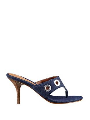 Wear your favorite denim in an unexpected way with these slip-on sandals. Silver-tone grommets play well with the dark indigo, making them the perfect addition to your iconic style.