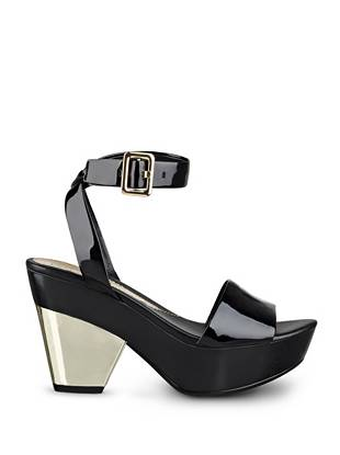 Master the of-the-moment slide trend with this sexy wooden sole pair. Featuring a sleek patent or shimmering metallic design, they add glamorous allure to your casual looks.