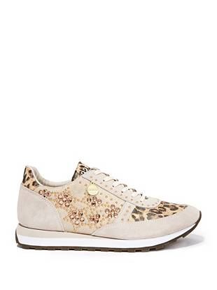 Who knew sneakers could be so glamorous? Gold-tone studs and dazzling rhinestones make this pair perfect for your off-duty days.
