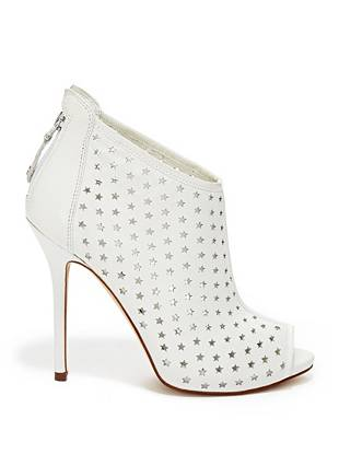 Perforated stars on a sleek leather ankle bootie: this high-fashion style gives