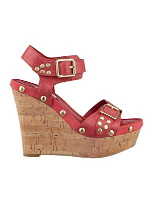 Every girl needs a wear-anywhere wedge in her wardrobe, and this pair is exactly that. Studded for rebellious edge, they make a sexy addition to any day or night look.
