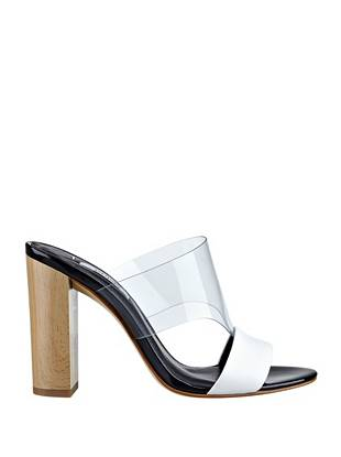 Get a head start on the Lucite trend by rocking these ultra-modern slip-on sandals. The chunky wooden heel adds an unexpected touch, taking this already-alluring style to a whole new level.
