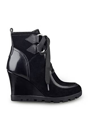 Wedge booties are back for the fall-to-winter seasons, and this pair takes that must-have trend to a whole new level. The modern mid-calf design and covetable mix of textures make them the perfect finish to your cold-weather street style.