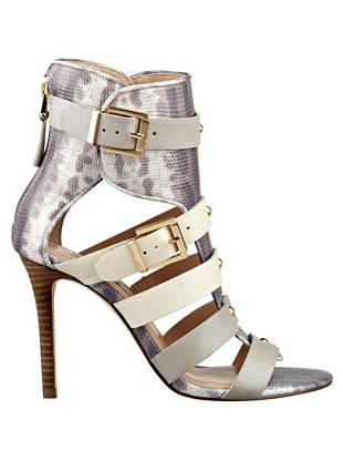 Make a daring style statement in these detail-rich gladiator sandals. Leather straps, gleaming gold-tone details and modern finishes deliver irresistible, all-eyes-on-me appeal.