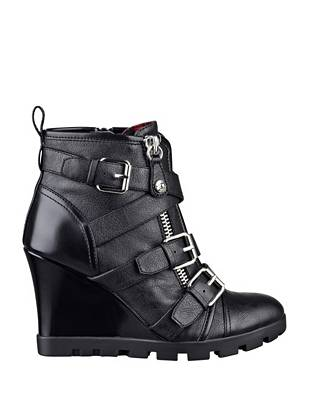A new twist on the must-have moto trend, these wedge booties are a front-runner for the fall season. Equipped with crisscross straps, buckles and zipper details, they take your off-duty looks to a whole new level.