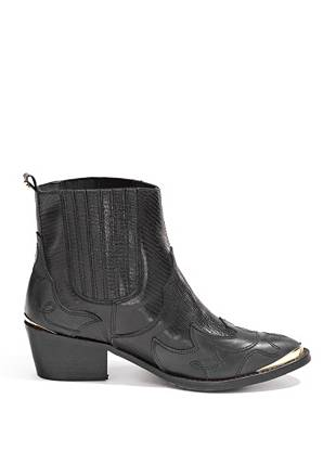 """Add a downtown-meets-western edge to any look with these on-trend ankle boots. Pair them with skinny jeans or a floral dress to elevate your day-to-day style.  •Ankle boots. Almond toe. Gold-tone hardware at toe. •Western-inspired detail •Pull-on construction. Lug sole. •1 ¾"""" heel •7"""" shaft height •Material: Leather"""