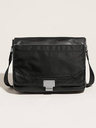 """You won't miss a beat with this leather and nylon cross-body bag slung against your side for day-to-night style. Rely on it from your commute to the office or school to keep your essentials organized.  •Nylon exterior with leather trim. Silver-tone hardware. •Logo plaque at front flap. Top zipper closure. Snap closure at flap. •Interior features two zipper pockets. Slip pocket under front flap. •Cross-body strap with adjustable buckle. 24"""" drop. •Logo-printed vinyl lining •10 ½""""W x 11""""H x 2 ½""""D"""