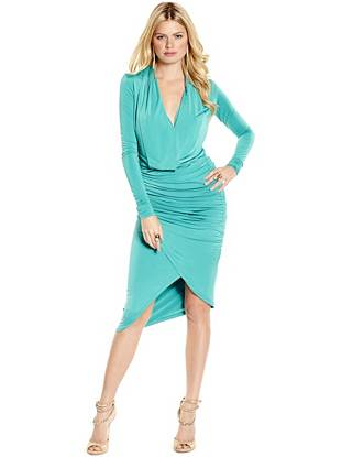 Sexy draping and delicate shirred details make this dress a flawless closet essential. Plus, the stretch knit hugs your curves in all the right ways, creating a flattering silhouette that's both seductive and chic.