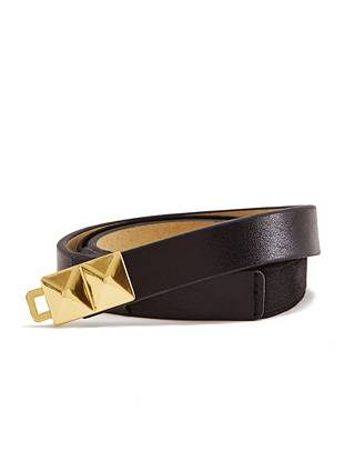 Effortlessly create a sexy hourglass silhouette with this waist-cinching belt. Gold-tone studs bring instant edge to the skinny, versatile style.