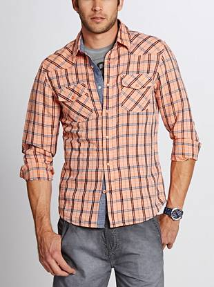 This updated Western shirt features comfortable linen-blend construction and an allover plaid pattern, making it the perfect wear-anywhere option.