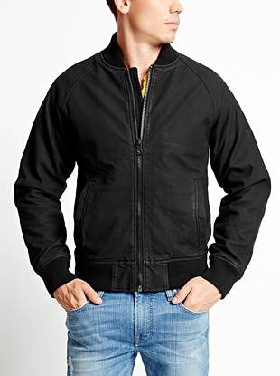 Athletic with modern edge, this faux-leather baseball jacket is right in line with the season's rocker-inspired vibe. The python-embossed texture makes it easy to dress up or down depending on your look.