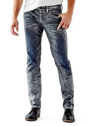 WHY YOU NEED IT: One of our fastest-growing fits, the Slim Taper is slim through the hip and thigh then tapers below the knee for a close-cut look. American denim is washed to a dark indigo shade then finished with a distressed metallic foil effect inspired by Nashville's world-renowned rock scene. Great for slim and straight builds.