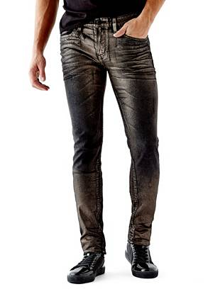 WHY YOU NEED IT: One of our fastest-growing fits, the Slim Taper is slim through the hip and thigh then tapers below the knee for a close-cut look. The American denim has a little stretch for comfort and a distressed metallic foil finish that's inspired by Nashville's world-renowned rock scene. Great for slim and straight builds.