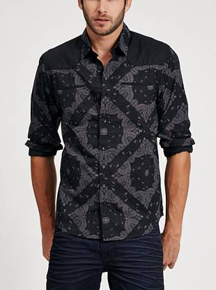 Get the most-wanted Western-inspired look with this woven button down. A bandana print and contrasting yoke puts a trend-driven spin on the classic slim cut.