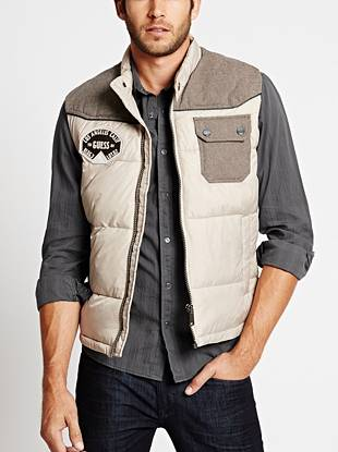 Casual and completely versatile, this puffer vest is ideal for the guy with rugged style. The mixed-material, color-blocked design gives it a modern look while the aviator-inspired logo patch delivers authentic vintage appeal.