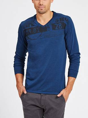 A distressed logo graphic gives this heathered V-neck a rugged, worn-in look.