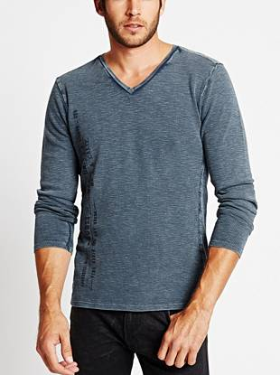 A distressed logo and worn-in design bring understated edge to this textured thermal tee.