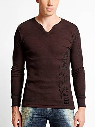A distressed burnout effect and stamped logo graphic give this long-sleeve tee a laid-back vibe.