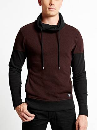 Bring modern edge to your laid-back looks with this soft pull-on sweater. The funnel collar delivers extra warmth during the colder seasons and the color-blocked design keeps you on trend.