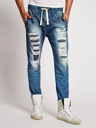 Sweats get a stylish revamp with this pair of lounge pants. A photo-real destroyed denim print, cozy fleece fabric and drawstring make these