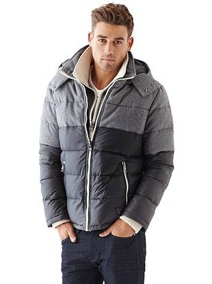 A modern mix of materials gives this basic puffer jacket a trend-driven look. The layered front placket design provides extra warmth while a removable zippered hood allows for an easy transition from day to night.