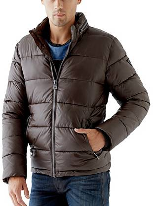 Perfect for both polished workdays and rugged weekends, this puffer jacket suits your versatile lifestyle. The zippered compartment opens to reveal a hidden hood, providing extra protection and warmth on the go.