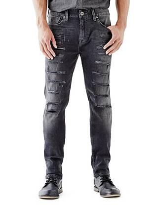 WHY YOU NEED IT: One of our fastest-growing fits, the Slim Taper is slim through the hip and thigh then tapers below the knee for a close-cut look. Black denim is washed and destroyed for a slightly faded, worn-in vibe that channels the season's rocker-inspired trend. Great for slim and straight builds.