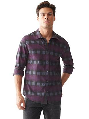 An edge-driven distressed effect instantly updates this basic plaid button-down.