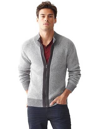 Equal parts rugged and polished, this marled-knit sweater is perfect for layering during the colder months.