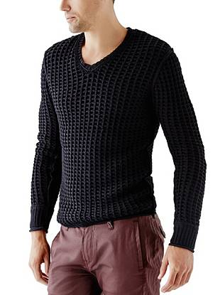 Get the must-have layered look in just one step with this open-knit V-neck sweater.