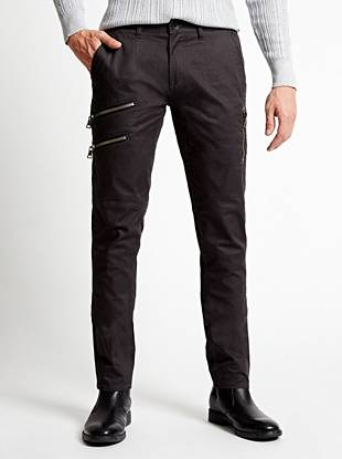 Bring modern edge to your casual style with these twill chino pants. Slim through the hip and thigh, this pair tapers below the knee for a close-cut look. Finished with moto-inspired stitching and zipper pockets, they are a subtle way to wear the rocker trend.