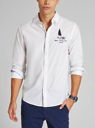 An embroidered sailboat logo punctuates this slim-fit button-down, while striped trim at the cuffs and inside placket put a new spin on classic prep style.