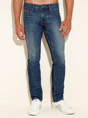 """Get the classic denim feel with a modern slim fit in these laid-back straight leg jeans.      • Low rise • Slim fit • Straight leg • Five pocket construction  • Belt loops • Zip fly • 10"""" front rise • 14 ¼"""" back rise • 16"""" leg opening • 32"""" inseam  • 100% Cotton • Machine wash     Measurements taken from a size 32     WALKER WASH: The Walker wash is on high-quality indigo denim from Turkey. This medium-weight comfort stretch fabric is made with a blend of cotton and polyester. The subtle sheen of the fabric is mixed with a vintage wash aesthetic through hand creased 3"""