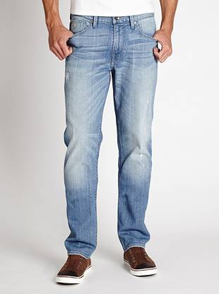 WHY YOU NEED IT: One of our fastest-growing fits, the Slim Taper is slim through the hip and thigh and tapers below the knee for a close-cut look. This pair is stone washed to a medium-light indigo and distressed just the right amount for a laid-back, worn-in effect. Great for slim and straight builds.