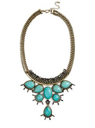 Timelessly elegant, this genuine turquoise statement necklace radiates glamour. Glittering rhinestones only add to the ornate design, making it a true piece of wearable art.