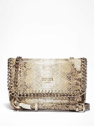 Ultra-chic with just enough edge—we're lusting over this petite cross-body bag. Sleek python print and chain details make for a rebellious statement that will turn heads.