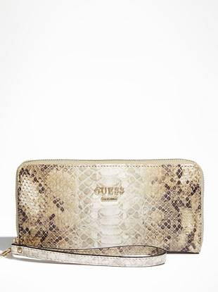 A sophisticated design and exotic python-embossed finish make this wallet/clutch combo the perfect plus one. Tuck it under your arm or slip it through your wrist for a modern finish wherever you go.