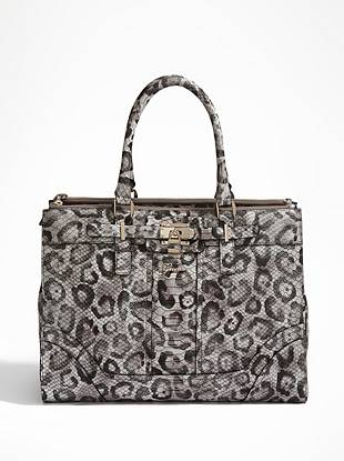 Instantly elevate your style status with this glamorously exotic carryall. The tough-luxe lock detail delivers trend-driven edge and the roomy divided interior keeps you organized on the go.