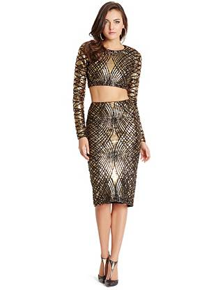 Count down to midnight in glamorously modern style with this crop top and midi skirt set. Adorned with an exquisite mix of gold and black sequins, it's a statement piece everyone will envy through the holidays and beyond.
