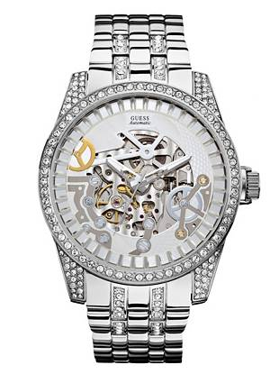 A tough-luxe exhibition-style dial and undeniably sparkling rhinestone trim ensure that this stunning watch makes a truly fashion-forward style statement.  •Automatic function •Watch dimensions in mm: 47/57/15 •Polished silver-tone case with rhinestone embellishment •White and silver-tone exhibition dial •Polished silver-tone link bracelet •Water resistant to 50m/165ft •10 Year Limited Warranty