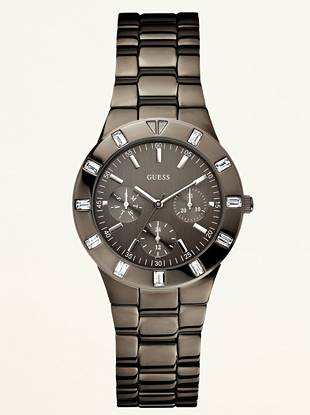 Finish your day-to-day looks with this classic grey watch that offers a sharp design and high shine.  • Multifunction: Day, Day and 24 hour international time • Watch measurements: 36/36/10.5 • Polished grey case and crystal top ring • Grey face • Grey polished bracelet • Water resistant • 10 Year Limited Warranty