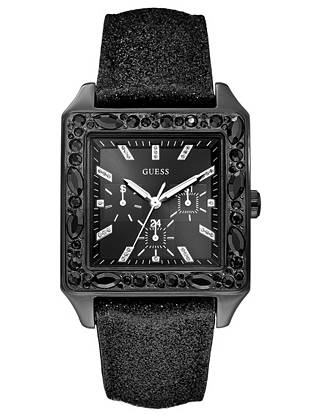 """Amp up the """"wow"""" factor on any look with this must-have sparkling watch. A glitter leather strap and dazzling crystals guarantee style envy. •Multifunction: day, date, and international time  •Watch measurements in mm: 49/44/12.5 •Polished black case with ionic plating and faceted crystal embellishment •Black dial with crystal embellishment •Leather strap with silver glitter. Adjustable. •Water resistant to 30m/100ft •10 Year Limited Warranty"""