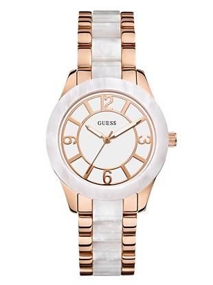 Radiant rose gold tones mix with pearlescent white to create this ultra-chic timepiece. The simple analog design makes for a polished finish to any day or night look.