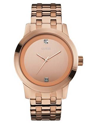 Wear this oversized watch with your favorite daytime looks for a look with guaranteed polish. A petite diamond accent adds just a hint of sultry sparkle. •Analog function •Watch dimensions in mm: 45/45/14 •Polished rose gold-tone case •Rose gold-tone dial with genuine diamond at 12 marker •Polished and brushed-finish rose gold-tone link bracelet •Water resistant to 100m/330ft •10 Year Limited Warranty