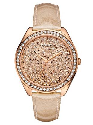Dare to dazzle with this ultra-glamorous watch. Gold-tone glitter and a bold spray of crystals deliver a can't-miss dose of night-out shine. •	Analog movement •	Watch measurements in mm: 45/45/11.5 •	Polished rose gold-tone case with crystal detail •	Rose gold-tone glitter dial with crystal detail •	Peach glitter patent leather strap •	Water resistant  •	10 Year Limited Warranty