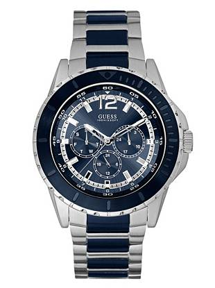 Nautical-inspired navy and a high-shine silver tone team up to create this ruggedly-designed timepiece. Featuring day, date and 24 hour international time functions, it's ideal for the on-the-go guy.