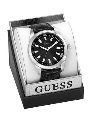 Sleek silver accents play off a bold black design in this perfectly polished dress watch. Packaged in a metallic logo box, it's the ultimate gift for the guy on the go.