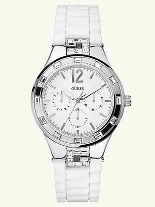 Brilliant sparkle makes this timepiece a must-have for the girl who loves to shine. Slip it on for a dazzling accent with perfect timing.  •Multifunction: day, date and 24 hour international time •Watch dimensions in mm: 38/43/12•Polished silver-tone case with crystals•White dial •White silicon strap•Water resistant up to 100 m/330 ft •10 Year Limited Warranty